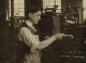 Operating an automatic press. Boston Index Card Co., 113 Purchase Street. Lewis W. Hine, 1917